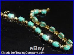 14k Yellow Gold Oval Sleeping Beauty Turquoise X Kisses Hug Tennis Link Bracelet