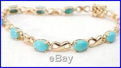 Sleeping Beauty Oval Turquoise Figure 8 Link 14k Gold Tennis Bracelet 6 3/4